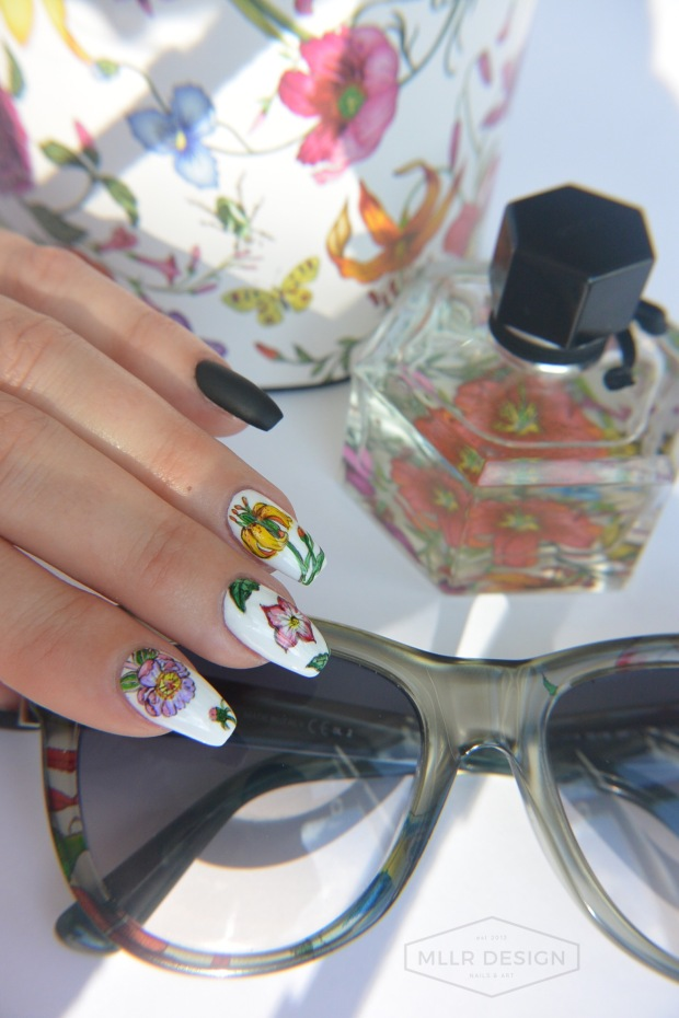Gucci Flora anniversary edition with matching nails and sunglasses.